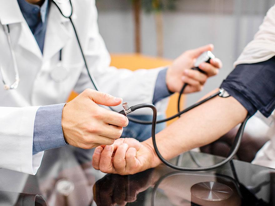 A doctor measuring blood pressure