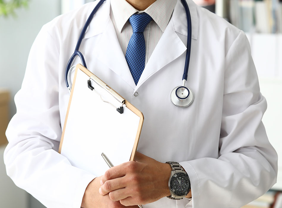 Male Doctor Holding Sheet